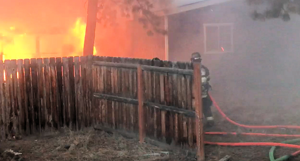 Firefighters tackle fire at home on Cinder Butte Road in Deschutes River Woods.