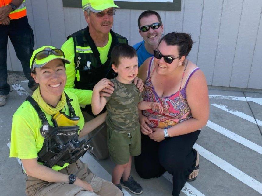 Nolan Erion with parents, rescuers