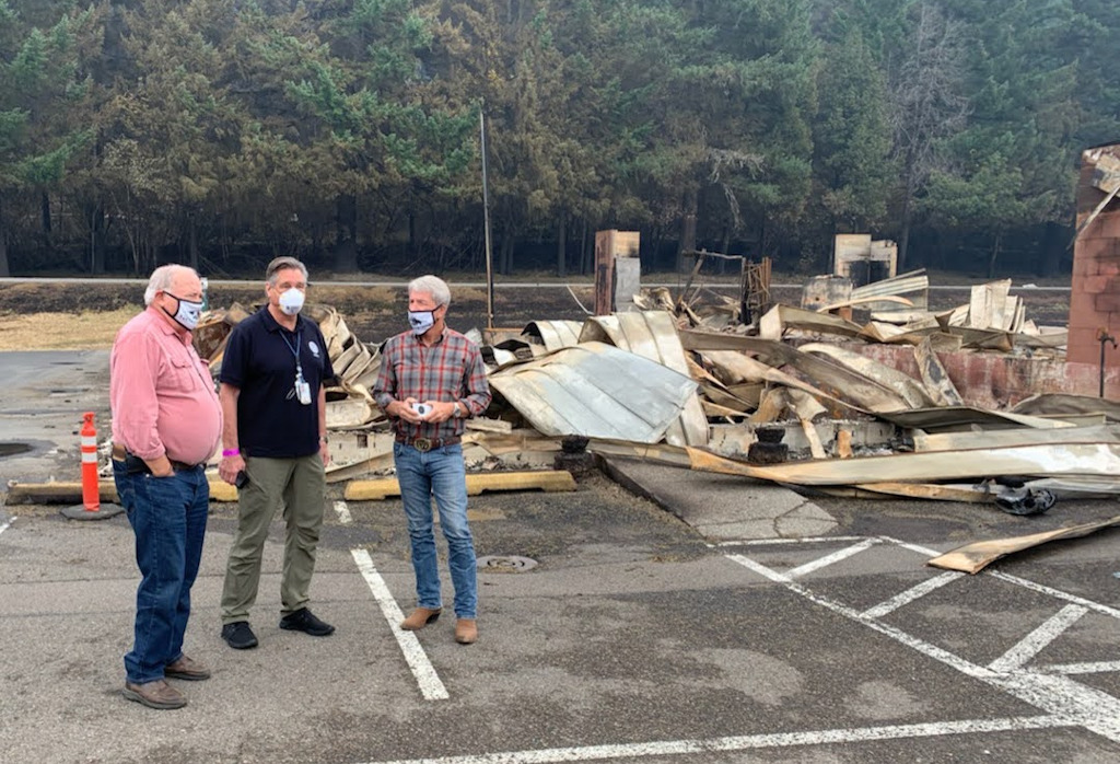 Detroit Mayor Jim Trett, Federal Coordinating Officer Dolph Diemont and Rep. Kurt Schrader tour fire-ravaged community on Saturday, Sept. 19.