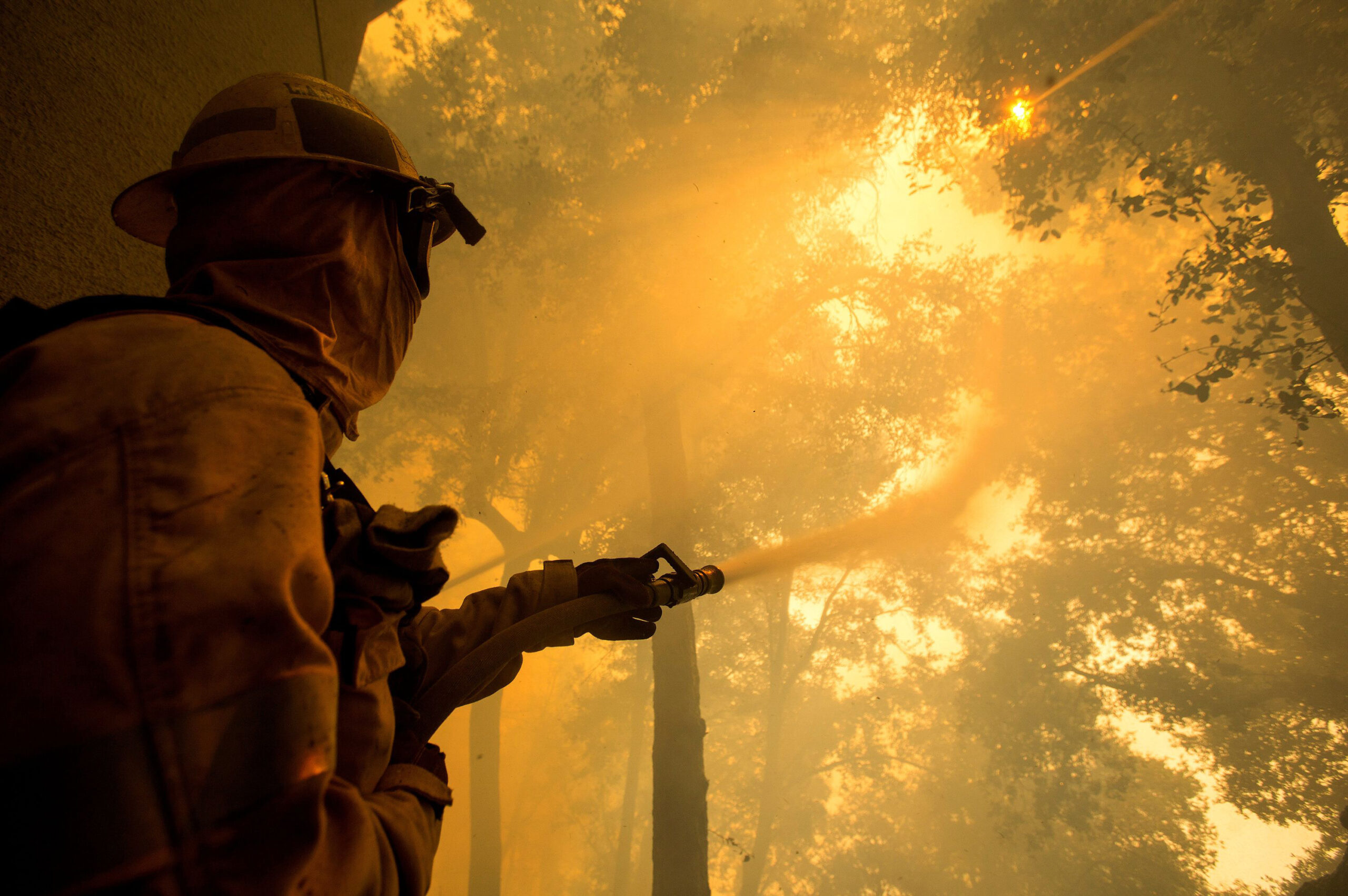 A firefighter battles a wildfire near a structure while defending the Mount Wilson observatory during the Bobcat Fire in Los Angeles on Thursday, Sept. 17, 2020