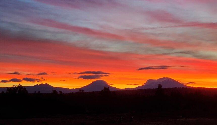 Sunset over mtns Gene Trahern 1017