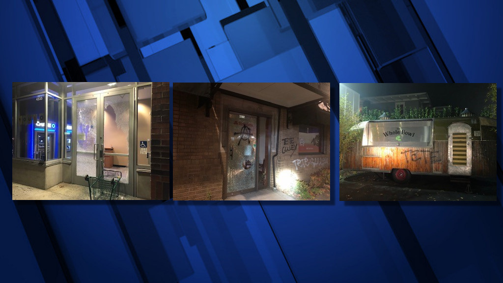 Portland police say more than two-dozen businesses were vandalized late Friday along NE Sandy Boulevard
