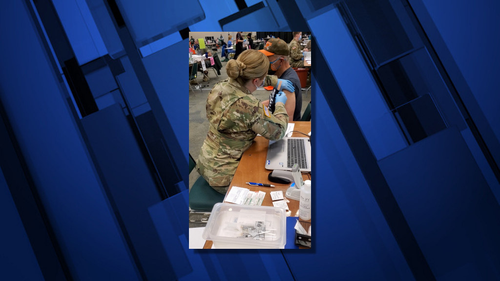 Oregon National Guard citizen-soldiers have been helping give COVID-19 vaccines at the Deschutes County Fairgrounds in Redmond