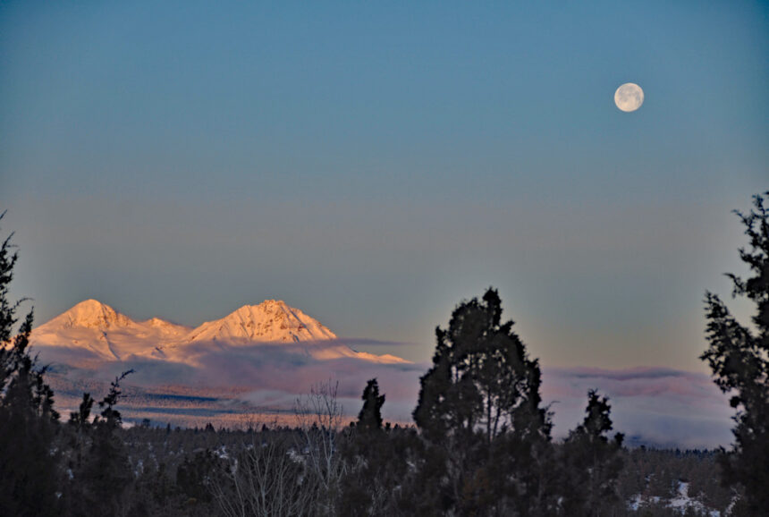Full moon setting over North and Middle Sister Marita Sutherlin