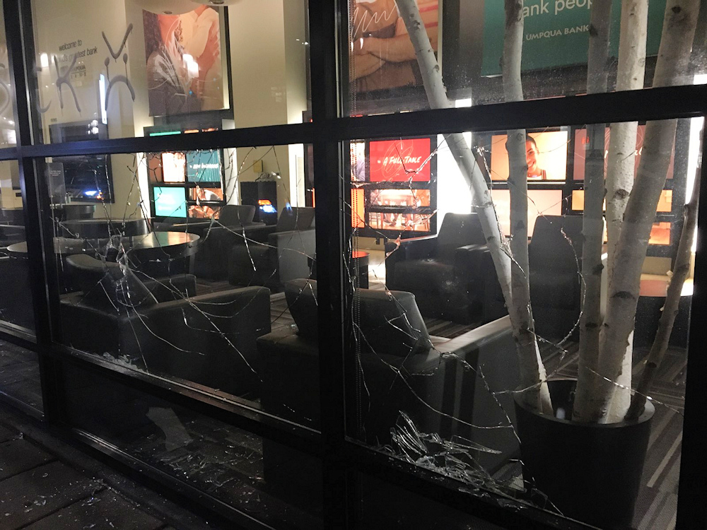 Violent protesters smashed windows of several Portland businesses Saturday night