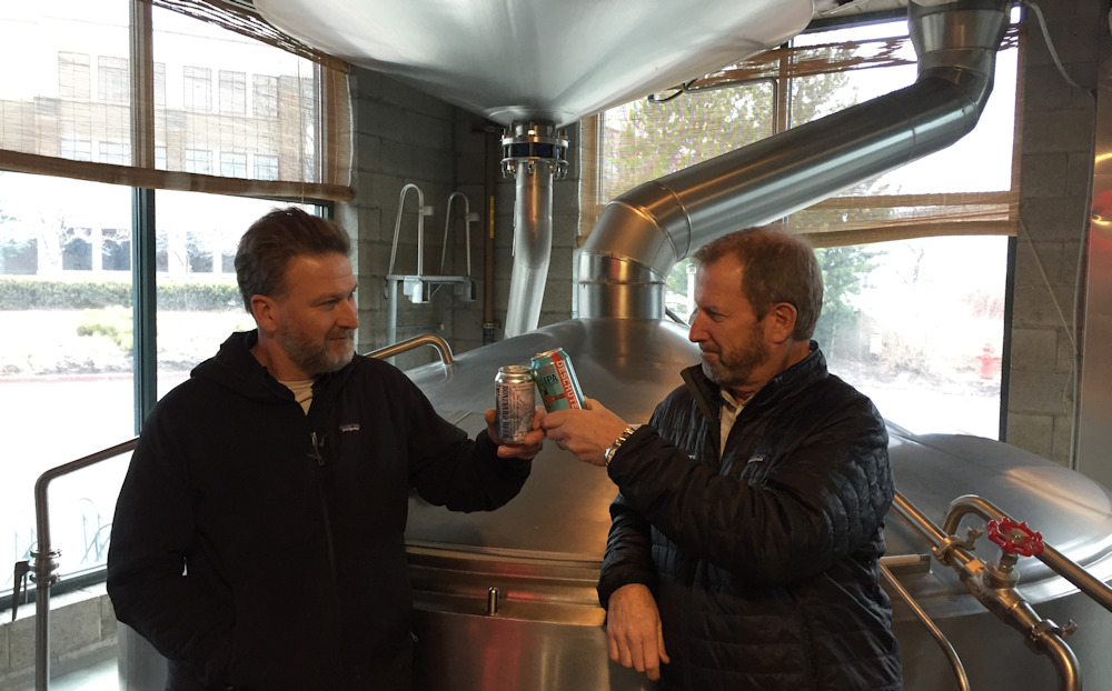 Tony Lawrence of Boneyard Beer and Gary Fish of Deschutes Brewery toasting this partnership in the JV brewhouse at Deschutes that Tony helped commission in the early 1990s
