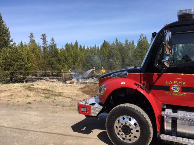 Rekindle burn pile escaped, sparking brush fire Tuesday afternoon
