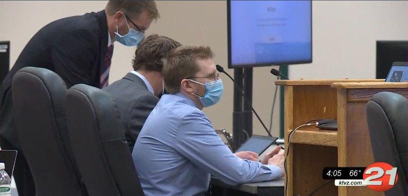 Luke Wirkkala sits by defense attorneys
