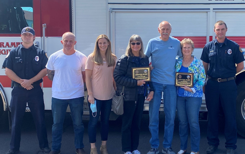 (L to R) Redmond Fire & Rescue EMT Emett Willis, Engineer / Paramedic Wade Bale, Public Safety Dispatcher Megan Happ, Charlotte Wooldridge, Sam Wooldridge, Gwen Wooldridge and Captain / Paramedic Josh Clark