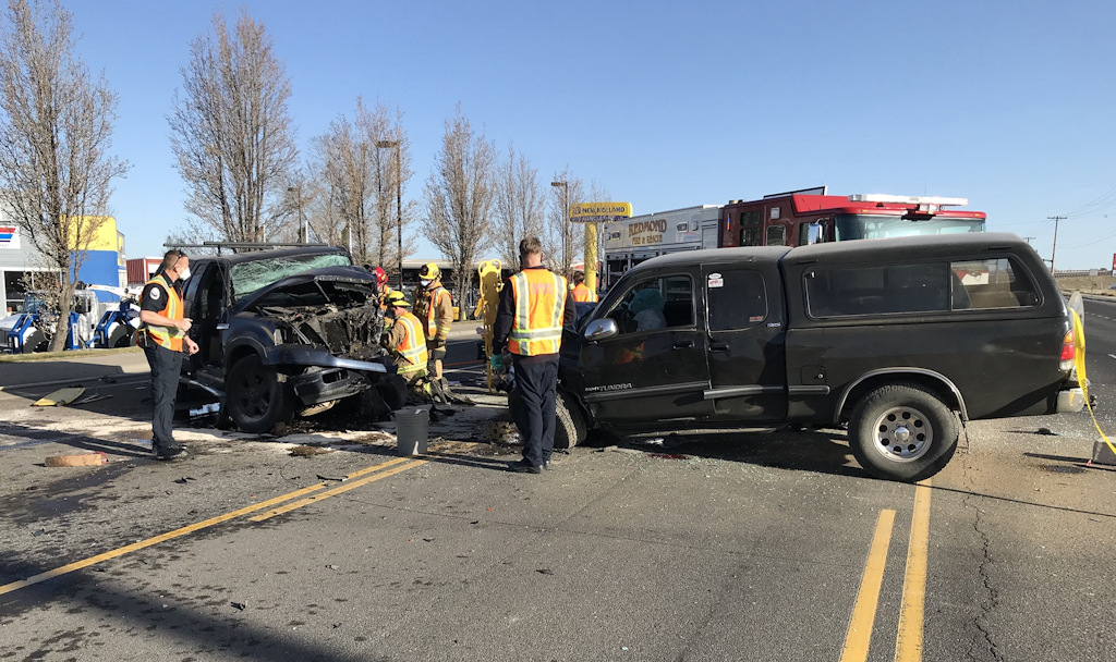Two pickup trucks collided Tuesday morning in NW Redmond