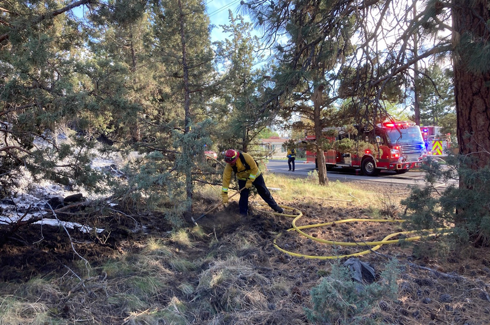 Bend firefighters doused a brush fire off SE 15th Street Wednesday evening