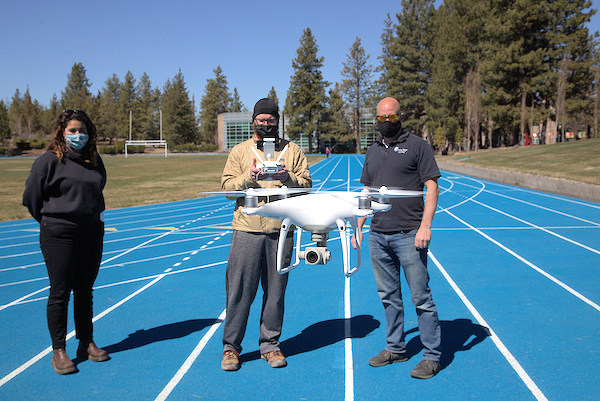 Students of COCC's GIS program utilize a drone for data collection