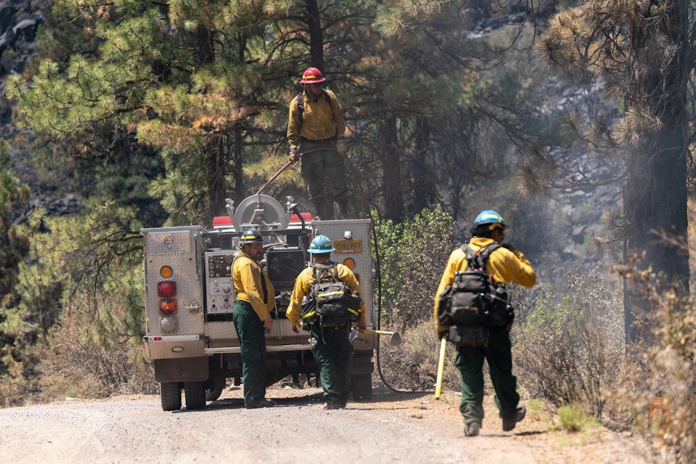 Engine crew provides water for mop-up on the Cutoff Fire north of Bonanza