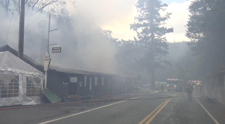 Smoke pours from remains of the Galice Resort in Merlin, west of Grants Pass