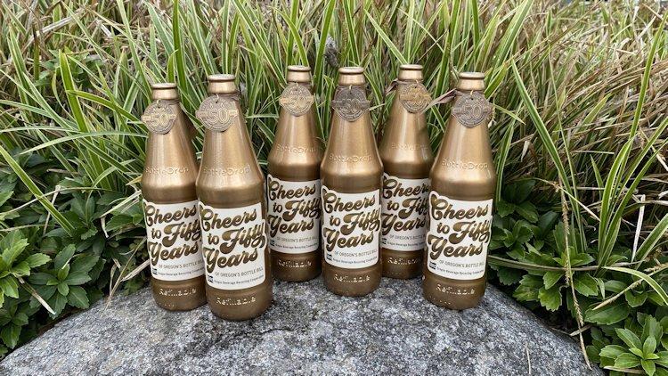 Commemorative, gold-colored bottles for Hidden Bottle Hunt