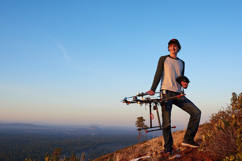 Bridger Cook, who received a 2021 Distinguished Student Award, atop Bessie Butte