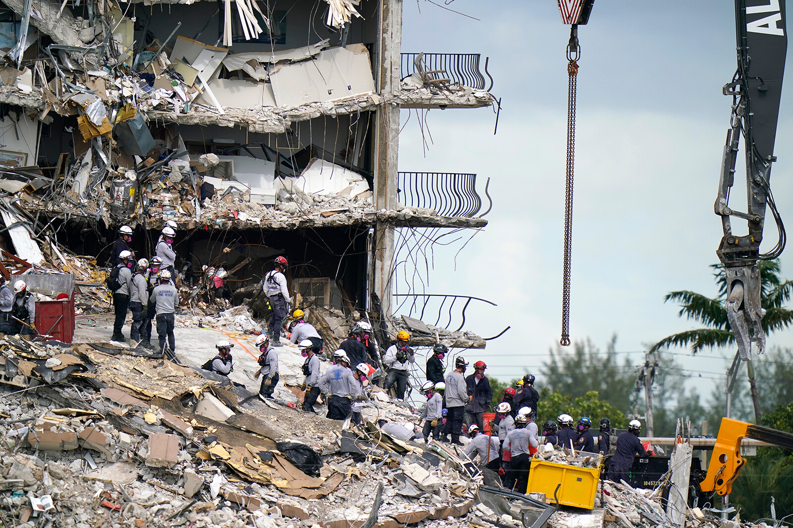 <i>Lynne Sladky/AP</i><br/>Rescue workers search in the rubble at the Champlain Towers South condominium on June 28 in the Surfside area of Miami.