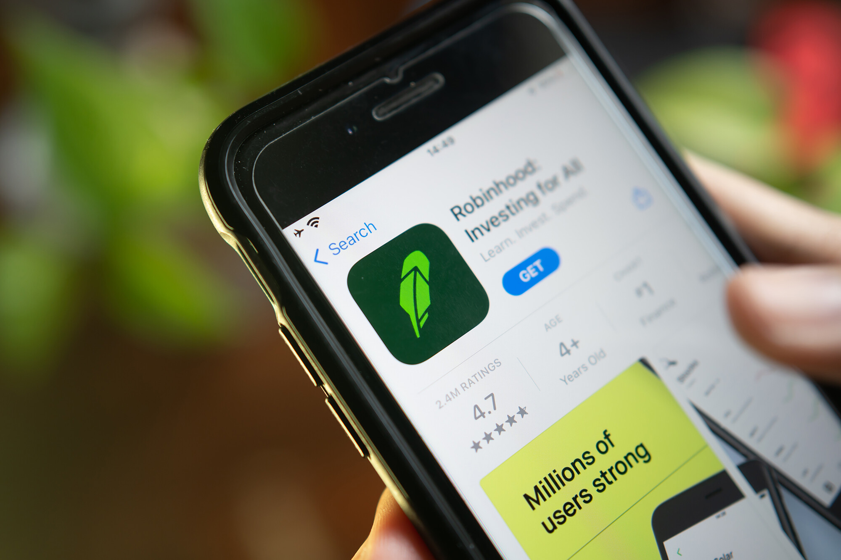 <i>Shutterstock</i><br/>An iPhone user downloading Robinhood App