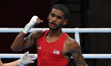 U.S. boxer Delante Johnson celebrates his victory over Argentina's Brian Agustin Arregui at the 2020 Tokyo Olympic Games