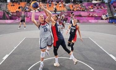 Stephanie Dolson draws a foul for the United States against France