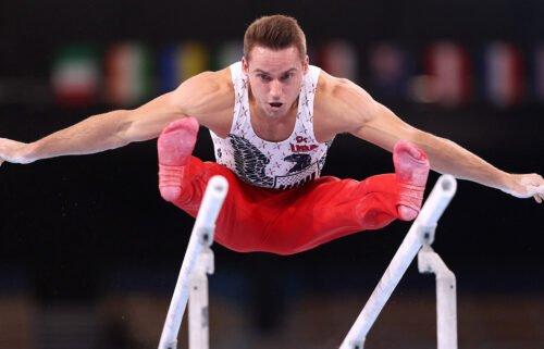Sam Mikulak competes on parallel bars