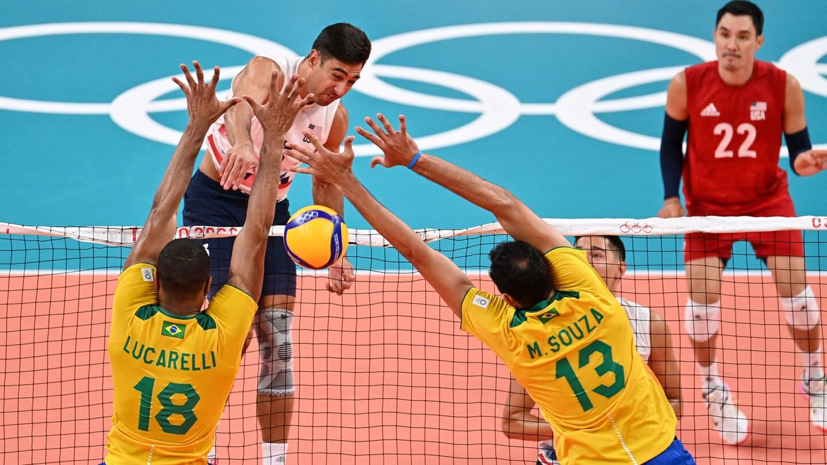 Taylor Sander spikes the ball vs. Brazil