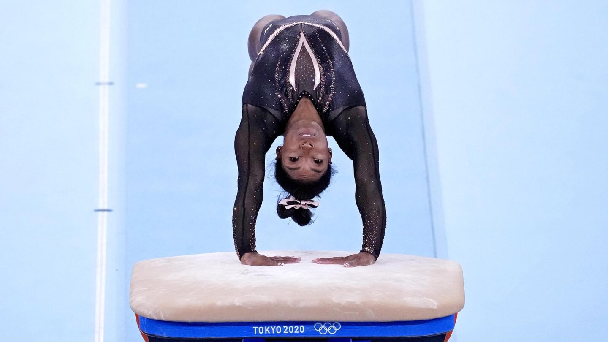 Simone Biles competes on vault