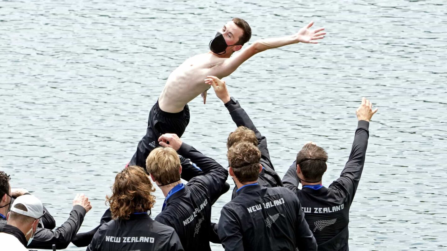 New Zealand celebrates winning the gold medal in the men's eight Friday at the Tokyo Olympics.
