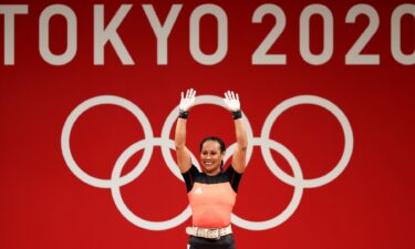 Dika Toua smiles after making history as first five-time female Olympian lifter