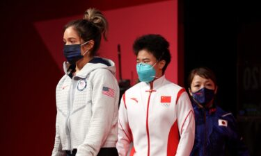 Jourdan Delacruz and Hou Zhihui walk toward the stage