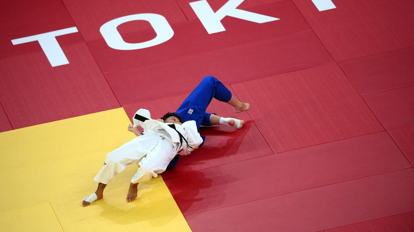 France's Amandine Buchard (white) competes with Switzerland's Fabienne Kocher during their judo women's -52kg semifinal A bout during the Tokyo 2020 Olympic Games at the Nippon Budokan in Tokyo on July 25