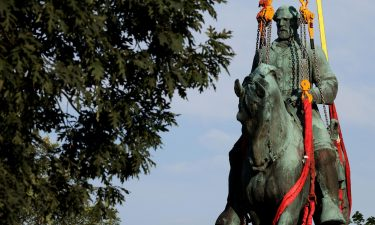 Workers remove a statue of Confederate Gen. Robert E. Lee from Market Street Park on Saturday in Charlottesville