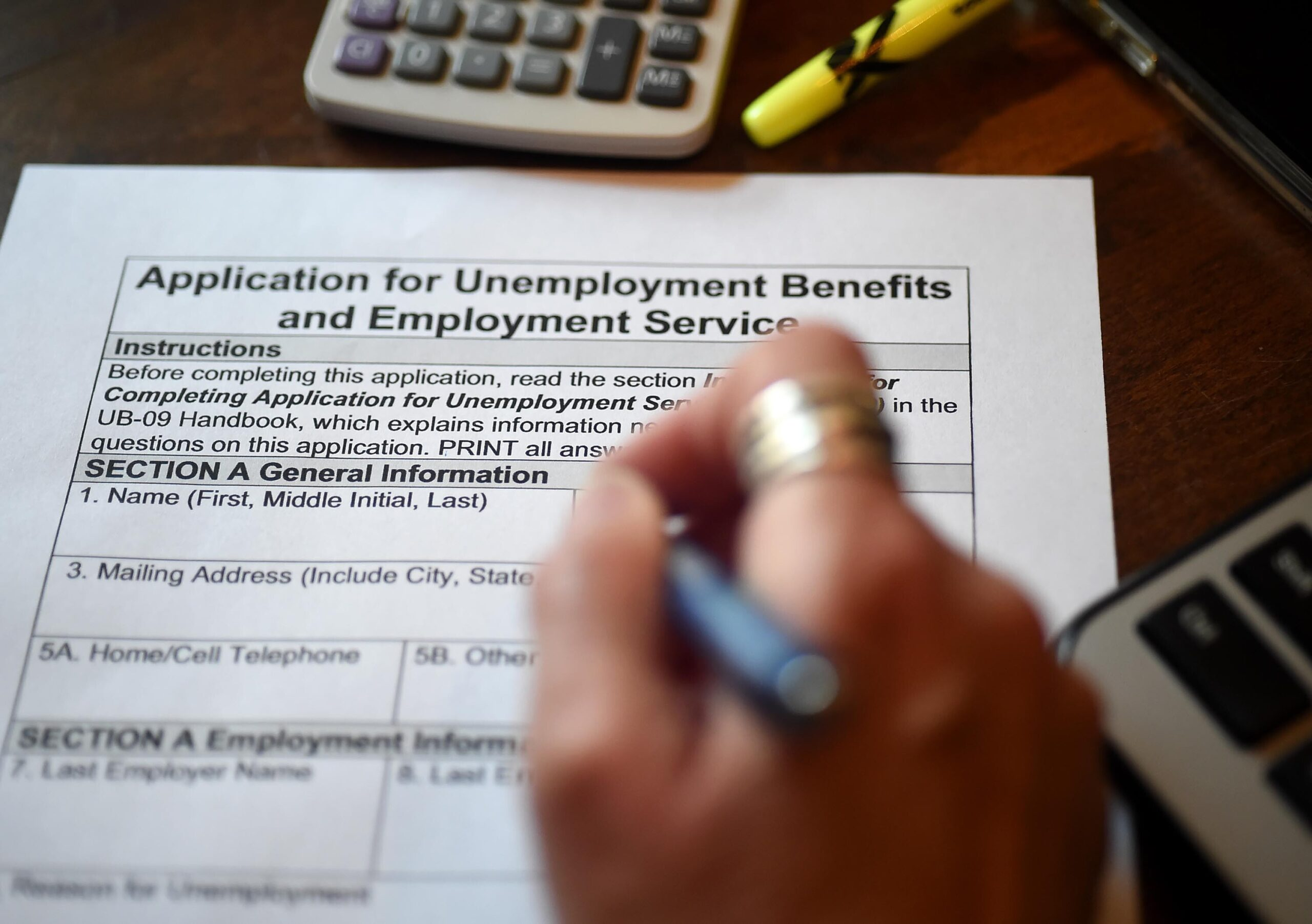 <i>OLIVIER DOULIERY/AFP/Getty Images</i><br/>Claims for US jobless benefits unexpectedly jumped last week offering the latest reminder that the American economy -- and the labor market -- are not yet back to normal.