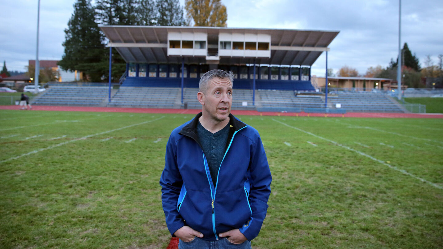 <i>Larry Steagall/Kitsap Sun via AP</i><br/>Former Bremerton High School assistant football coach Joe Kennedy stands at the center of the field on the 50 yard line at Bremerton Memorial Stadium