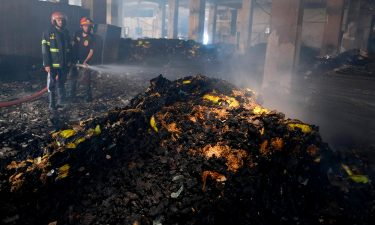 Firefighters work to douse the fire at the factory on Friday.