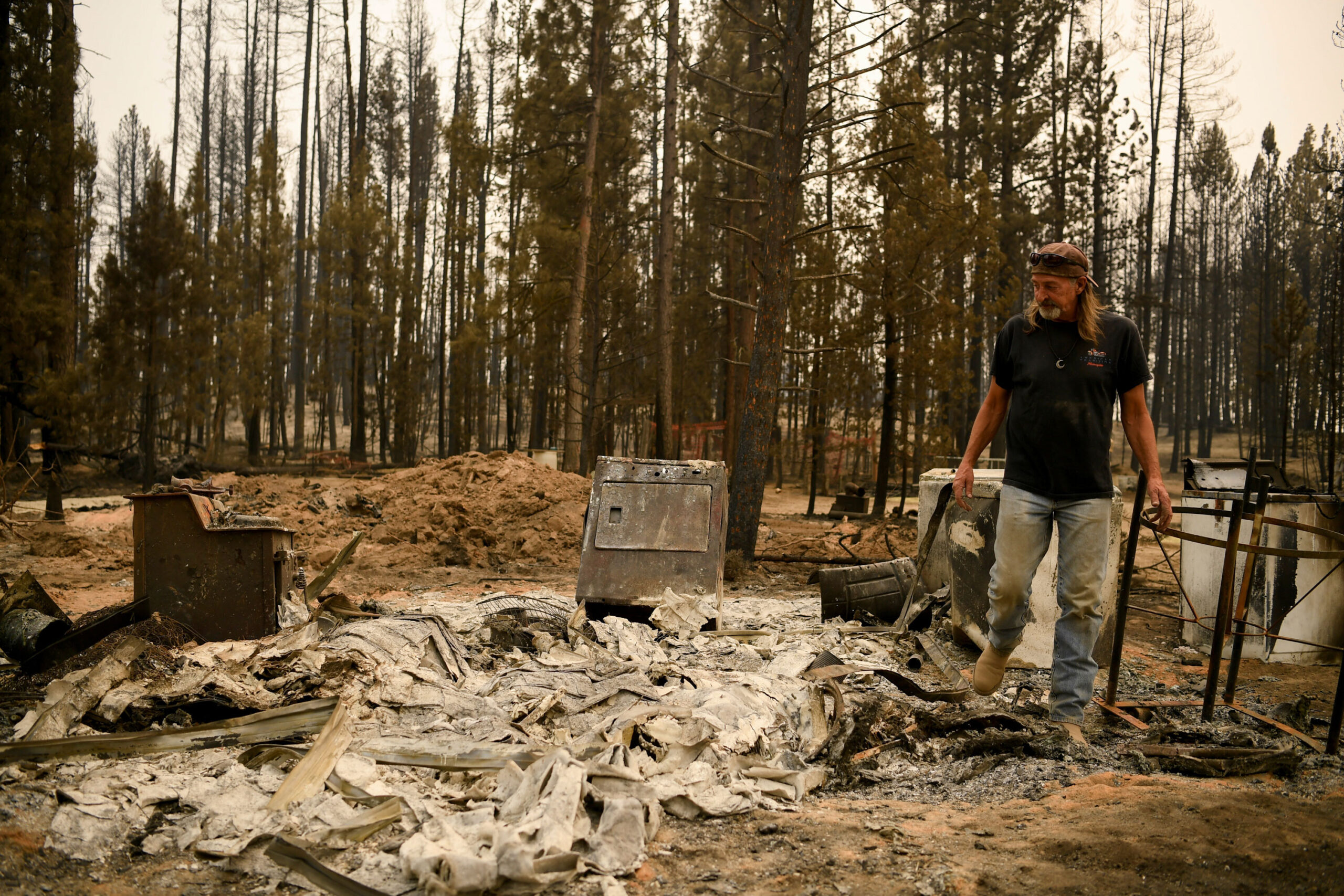 <i>Mathieu Lewis-Rolland/Reuters</i><br/>Scott Griffin surveys his property which was destroyed by the Bootleg Fire