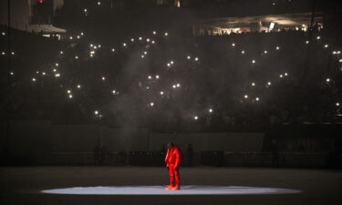 Kanye West took to the stage Thursday at Mercedes-Benz Stadium in Atlanta but he was silent