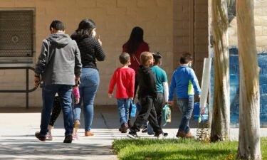 Students wearing masks head to lunch break during summer school at Hooper Avenue Elementary School in Los Angeles on June 23.