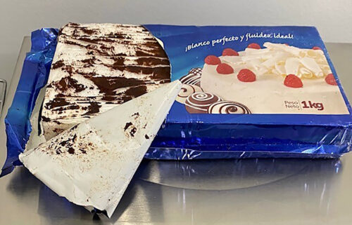 The Maine Drug Enforcement Agency seized cocaine disguised as a cake from a vehicle along I-295 as it entered the city of Gardiner.
