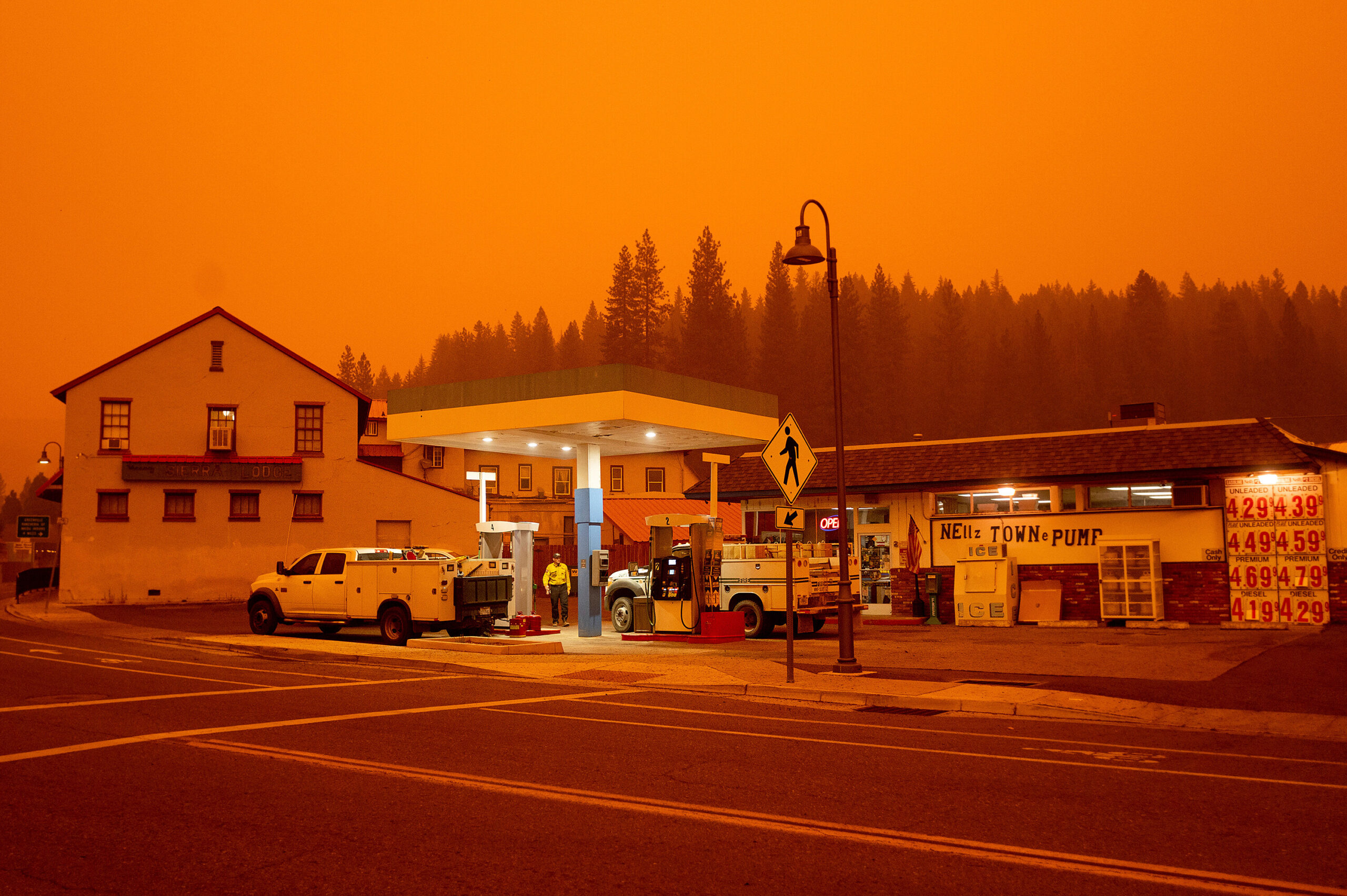 <i>Noah Berger/AP</i><br/>Firefighters gas up while battling the Dixie Fire in the Greenville community of Plumas County