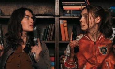 "Lena Heady and Karen Gillan play assassins in ""Gunpowder Milkshake."""