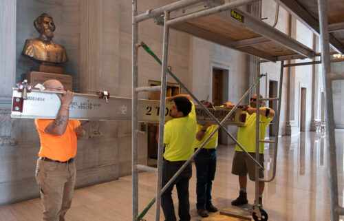 Workers prepare scaffolding at the Nathan Bedford Forrest bust in the State Capitol in Nashville