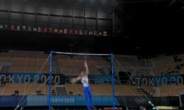 Japan's Uchimura falls off high beam in men's gymnastics