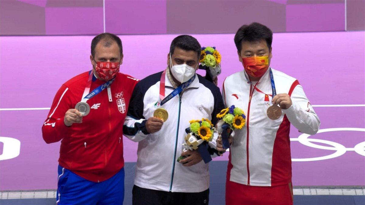 Medal ceremony for the men's 10 meter air pistol