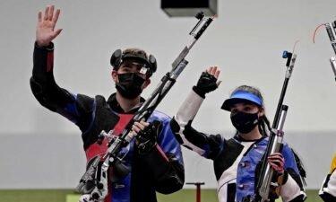 U.S. air rifle team waves