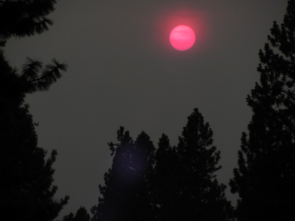 A red or orange sun has been a frequent sight across the High Desert recently, as in this sunset view in Bend on Wednesday evening