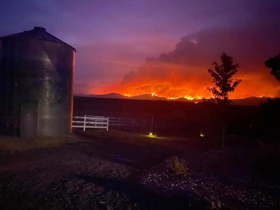 Cougar Peak Fire glows on the horizon