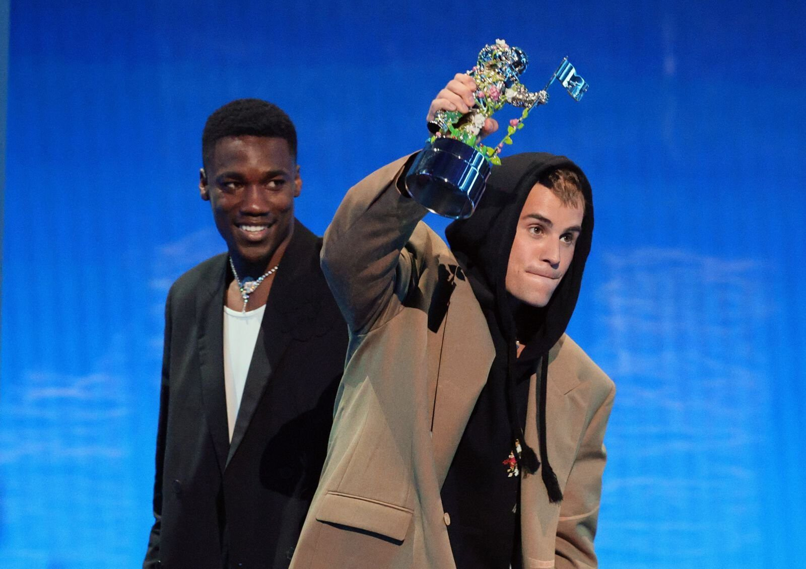 <i>Theo Wargo/Getty Images</i><br/>Giveon and Justin Bieber accept the award for Best Pop. Bieber was also awarded Artist of the Year.