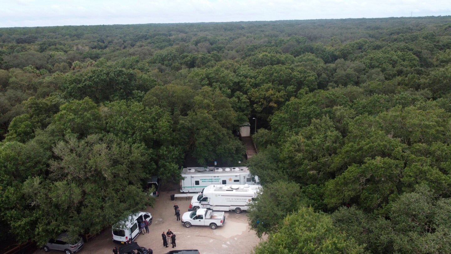 <i>North Port Police Department/AP</i><br/>Law enforcement officials conduct a search of the vast Carlton Reserve in the Sarasota
