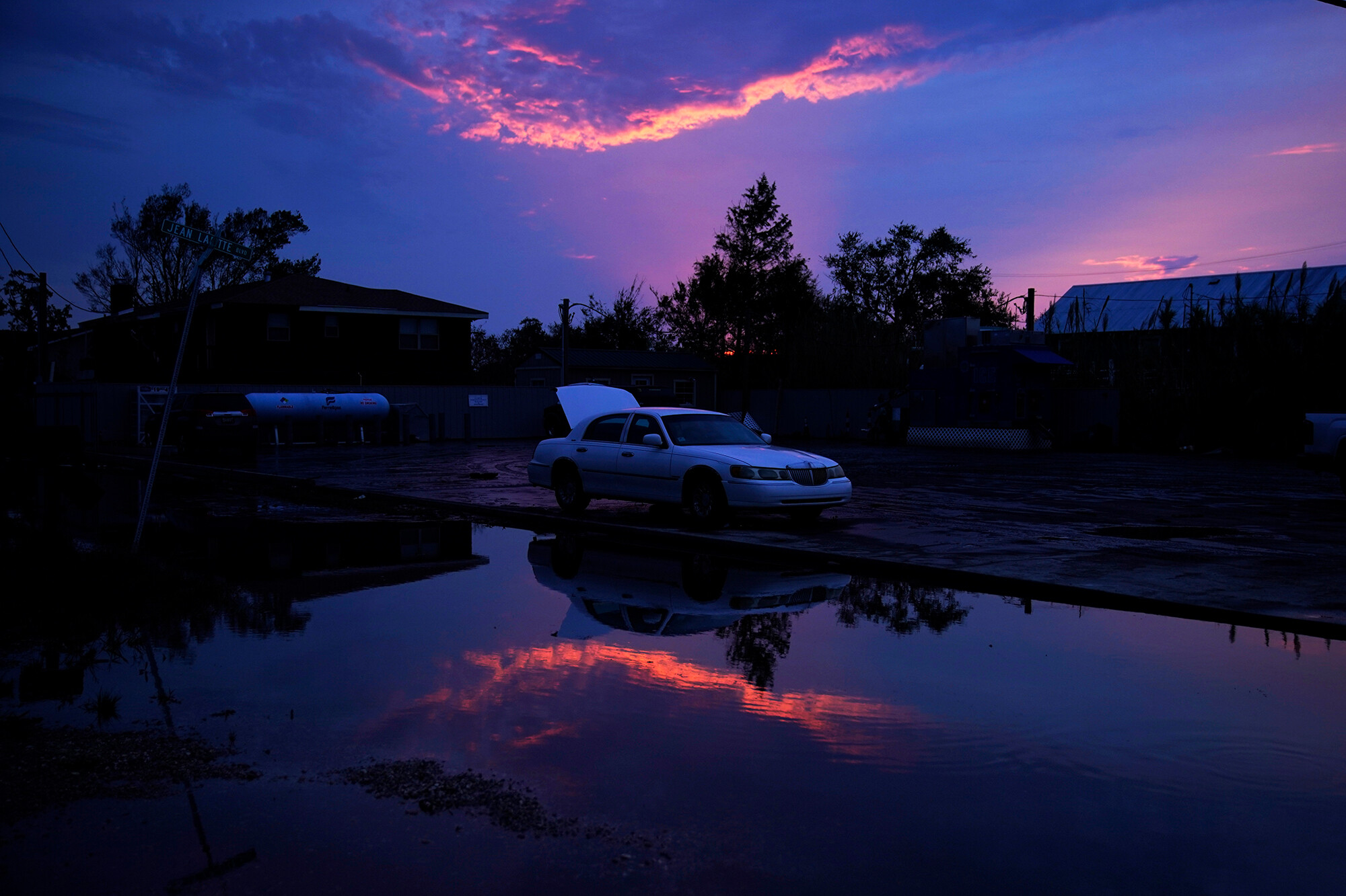 <i>John Locher/AP</i><br/>Car prices are about to soar again. Blame Hurricane Ida. A damaged car sits beside floodwaters in the aftermath of Hurricane Ida in Jean Lafitte